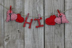 Red hearts and Hi hanging on clothesline Stock Photography