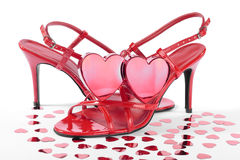 Red hearts and high heel red  shoes over white Royalty Free Stock Photography