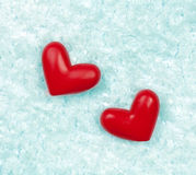 Red hearts on the ice Royalty Free Stock Photos