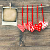 Red hearts and instant polaroid photo frame. Valentines Day. Concept. Mock up with space fot your photo Stock Photography
