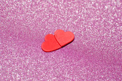 Red hearts. Isolated on the pink sparkling background stock photos