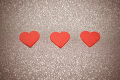 Red hearts. Isolated on the pink sparkling background royalty free stock image