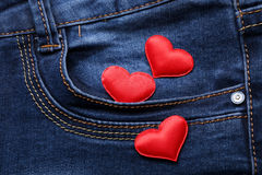 Red hearts on jeans backround Stock Photo