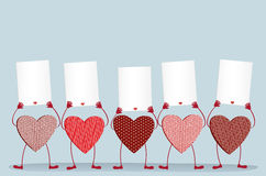 Red hearts with legs and hands holding empty blanks  pages Royalty Free Stock Photos