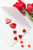 Red hearts ,letter and tulips Stock Photography