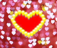 red hearts in light bulb on defocused background Royalty Free Stock Images