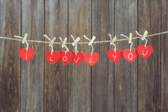 Red hearts on line. Over a old wooden boards background royalty free stock photo