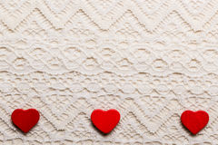 Red hearts love symbol on lace background Stock Photos