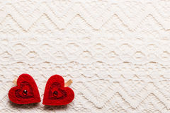 Red hearts love symbol on lace background Stock Image