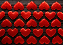 Red hearts made of cloth. On a bamboo leaf stock photo
