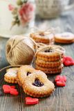 Red hearts marzipan and Linzer Cookie. Royalty Free Stock Images