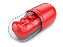 Red hearts in the medical capsule. Stock Images