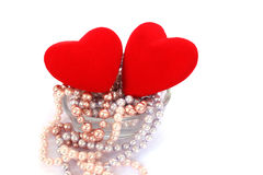 Red hearts and necklase in vase Royalty Free Stock Photos