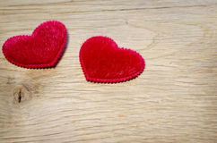 Red hearts are on  oak planks Royalty Free Stock Image