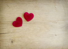 Red hearts are on  oak planks Stock Photos