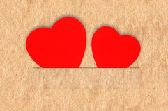 Red hearts on Old Paper Texture Royalty Free Stock Photography