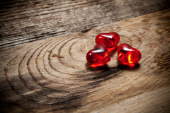 Red hearts on old wooden table Royalty Free Stock Photo