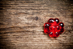 Red hearts on old wooden table Royalty Free Stock Image
