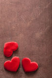 Red hearts over wooden background for Valentines day Stock Image