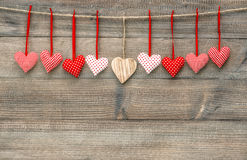 Red hearts over wooden background. Valentines Day decoration Stock Image