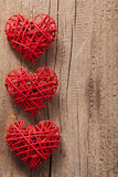 Red hearts over wooden background for Valentines Royalty Free Stock Photography