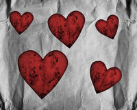 Red hearts on paper Royalty Free Stock Images