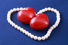 Red hearts and pearls Royalty Free Stock Image
