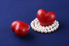 Red hearts and pearls Stock Photography