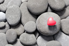 Red hearts on pebble stones. Valentine's Day background Royalty Free Stock Photography