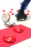 Red hearts with pen and ink, and Clock. On a white background royalty free stock image