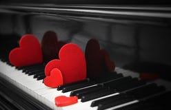 Red hearts on piano keys. Close up Royalty Free Stock Image