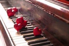 Red hearts on piano keys. Closeup Royalty Free Stock Photo