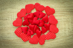 Red hearts pile Stock Images
