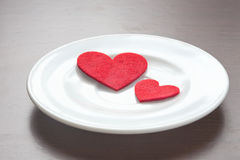 Red hearts on a plate. Valentine's Day Royalty Free Stock Photo