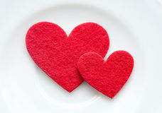 Red hearts on a plate close-up. Valentine's Day Royalty Free Stock Image