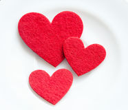 Red hearts on a plate close-up. Valentine's Day Royalty Free Stock Photography