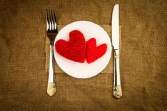 Red hearts on the plate Stock Photo