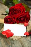 Red hearts, postcard and roses. Stock Image
