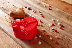 Red hearts and present box on wooden table Royalty Free Stock Photo