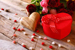 Red hearts and present box on wooden table Stock Images