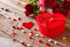 Red hearts and present box on wooden table Stock Image