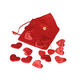 Red hearts on red pouch Stock Image