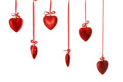 Red hearts on ribbon Stock Images