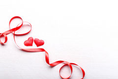 Red hearts and ribbon on light background Royalty Free Stock Image