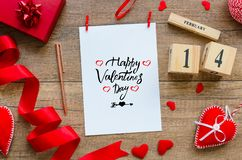 Red hearts, ribbon, perpetual calendar with date 14 february message greeting card with text happy valentines day and. Gift box on wooden table. Valentines Day stock photos