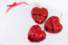 Red hearts and ribbon on white Royalty Free Stock Image