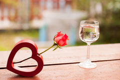 Red hearts and a roses on wooden , Valentines Day background. Stock Photography