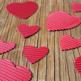 Red hearts on a rustic wooden surface. Some red hearts of different sizes on a rustic wooden surface Stock Image