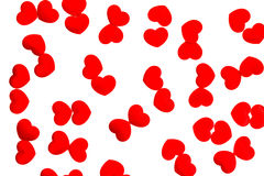 Red hearts scattered on white background Stock Image