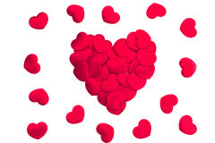 Red hearts scattered on white background Stock Images